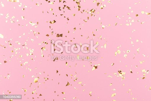 istock Golden sparkles on pink 1040055260