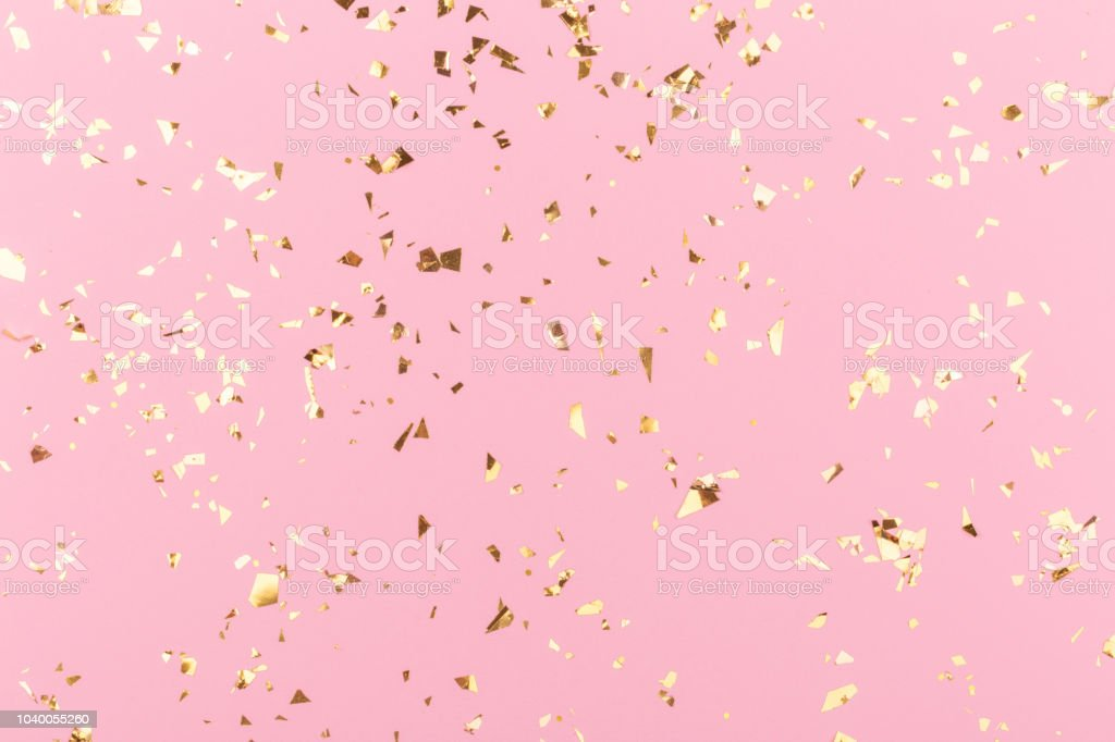 Golden sparkles on pink stock photo