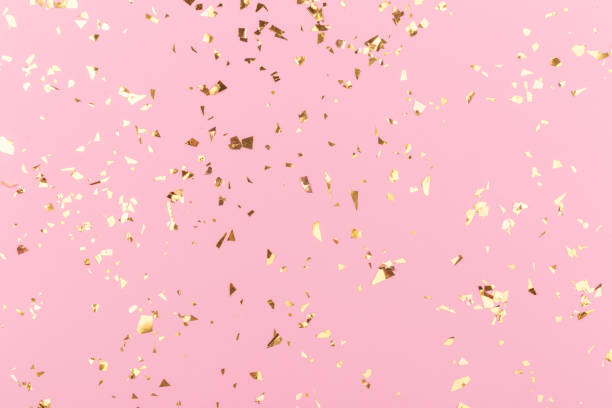 Golden sparkles on pink Golden sparkles on pink pastel trendy background. Festive backdrop for your projects. celebration stock pictures, royalty-free photos & images