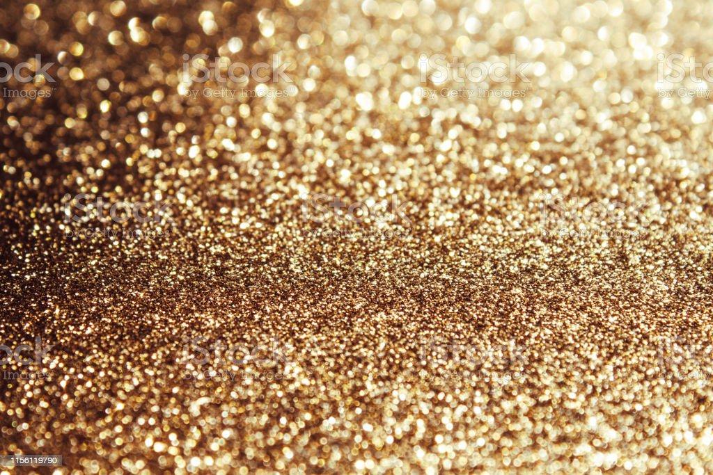 Golden abstract bokeh background, defocused Christmas lights. Festive...