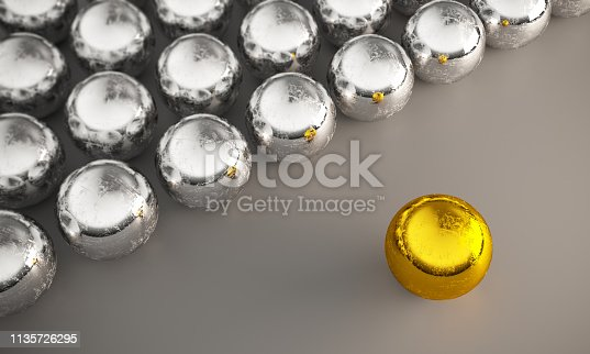 Scratched golden sphere standing out from steel spheres. ( 3d render )