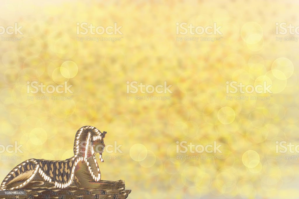 Golden sphinx ancient egypt with golden shinig bokeh background. Template for travel agency with space for your display product montage. stock photo