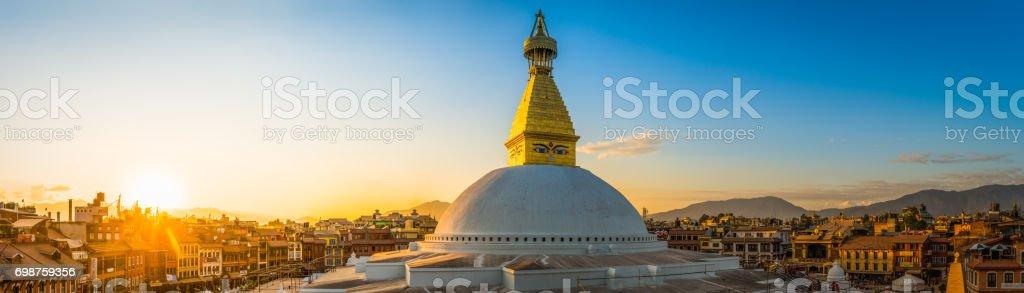 Golden spire Buddhist stupa temple illuminated sunset Boudhanath Kathmandu Nepal stock photo