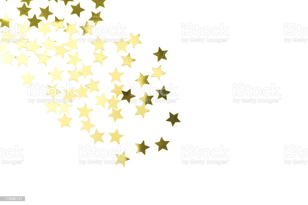 Golden star confetti scattered on white background stock photo