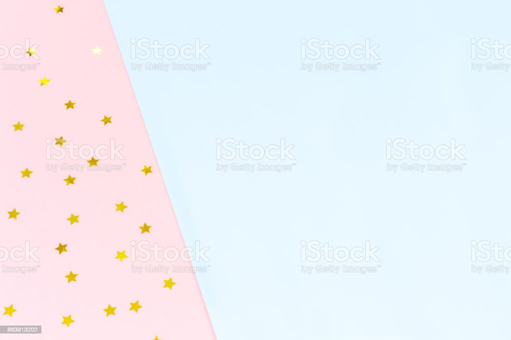 Golden star sprinkles on double pink and blue. Festive holiday background. Celebration concept stock photo