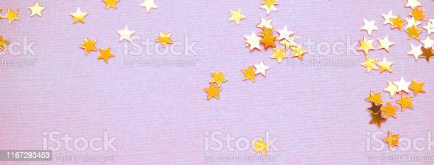 Golden stars glitter on lavender paper background picture id1167293453?b=1&k=6&m=1167293453&s=612x612&h=hoimiie51x8menqyaud pivnorontswace2945gda4w=