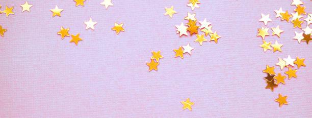 Golden stars glitter on lavender paper background picture id1167293453?b=1&k=6&m=1167293453&s=612x612&w=0&h=lmxd34dgmhd0h2mglv9e7s p picqmzycsssxdzktc8=