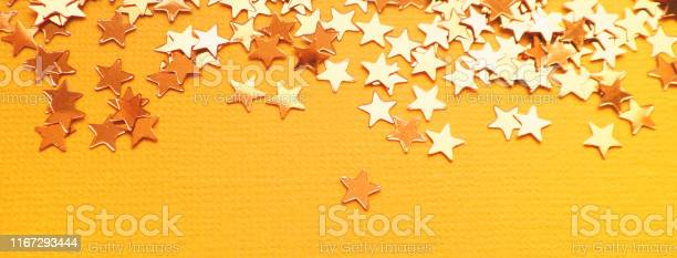 Golden stars glitter on orange paper background picture id1167293444?b=1&k=6&m=1167293444&s=612x612&h= xnbjcf hqeney1crxo1n7nl9qt3tlznpujnbar6tpw=