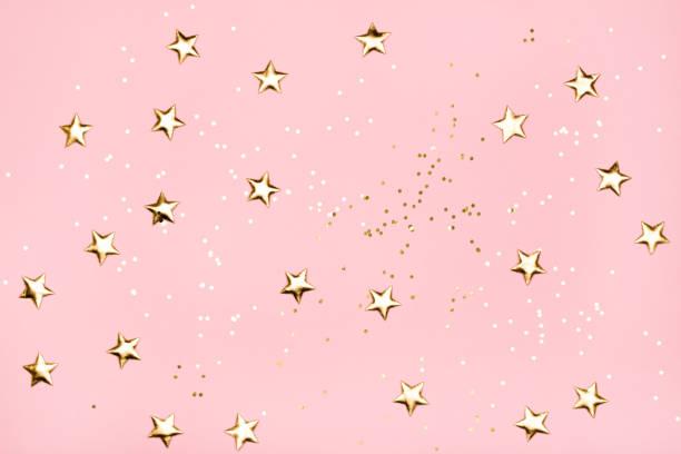 Golden stars glitter on pink background picture id887494880?b=1&k=6&m=887494880&s=612x612&w=0&h=b7zqtuhyrs khovhpd9rhyj4ajumnusvrh9stlbl1zu=