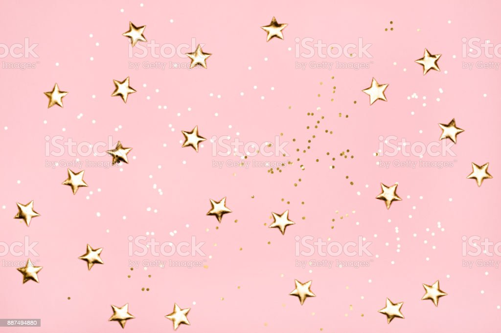 Golden stars glitter on pink background. stock photo