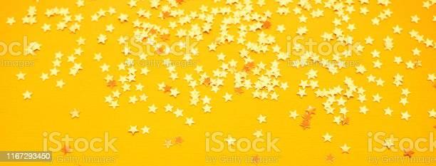 Golden stars glitter on yellow paper background picture id1167293450?b=1&k=6&m=1167293450&s=612x612&h=jxhvucd t8fe 1evy3w0iae tnidlv1axs ghujqwu0=