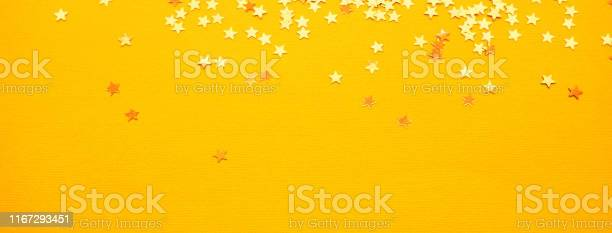 Golden stars glitter on yellow paper background picture id1167293451?b=1&k=6&m=1167293451&s=612x612&h=pv qmi0tghrudimrpswln3cxd8otthlzkibp16bfciw=