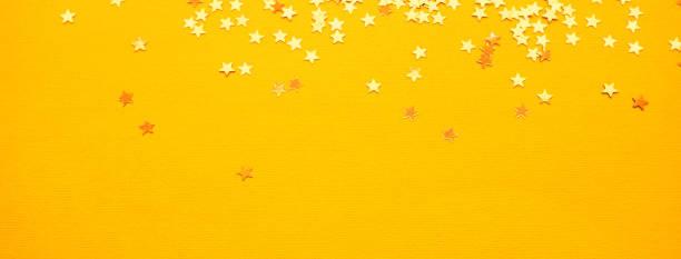 Golden stars glitter on yellow paper background picture id1167293451?b=1&k=6&m=1167293451&s=612x612&w=0&h=pxr k6lddf atwaz5zv t yfzuoccxj1gujd7b73mik=