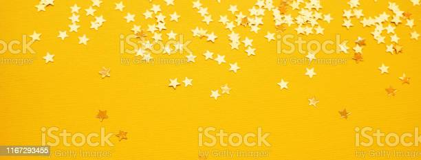 Golden stars glitter on yellow paper background picture id1167293455?b=1&k=6&m=1167293455&s=612x612&h=1ckygrs9if3jdmjh9o6ue09pzi0o5b1ft8zft6n ovk=