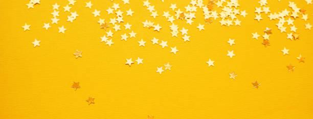 Golden stars glitter on yellow paper background picture id1167293455?b=1&k=6&m=1167293455&s=612x612&w=0&h=ehdt7lsfcmb4dbjwtme3dlvasa5safbhgciy0txo qc=