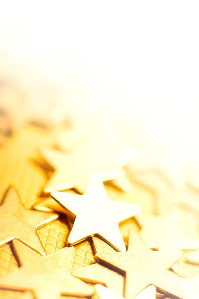 Golden stars in bright background stock photo