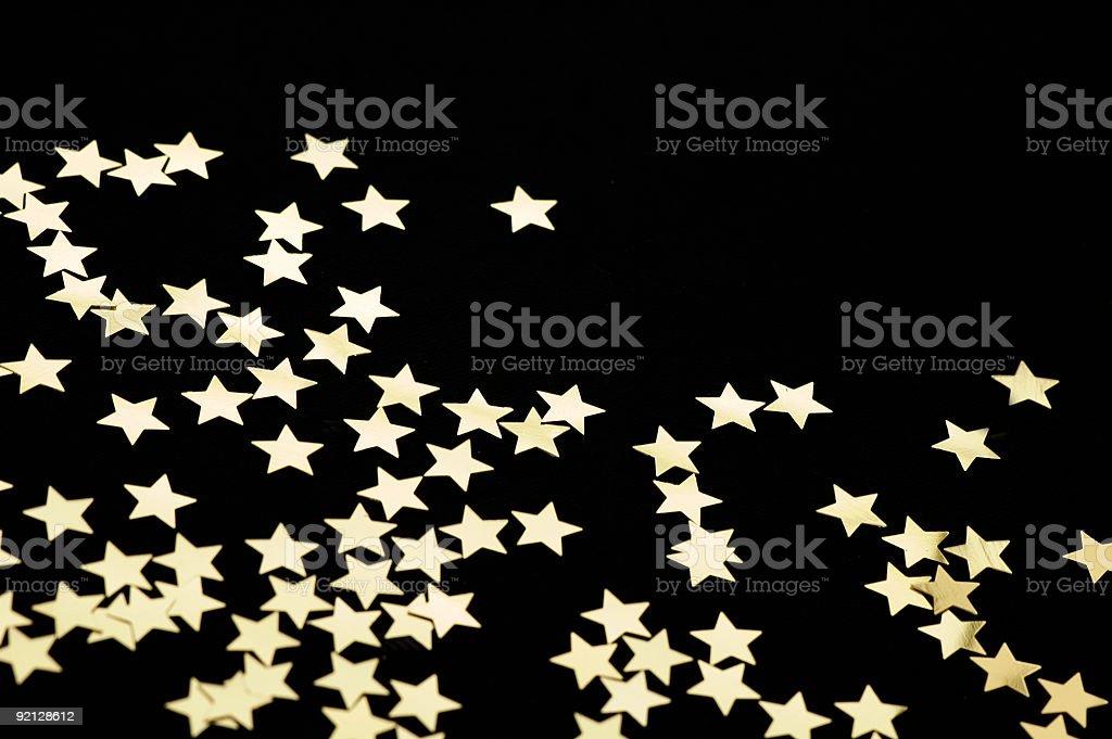 Golden Stars on a Black Background stock photo