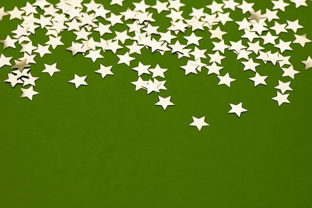 Golden Stars on Green stock photo