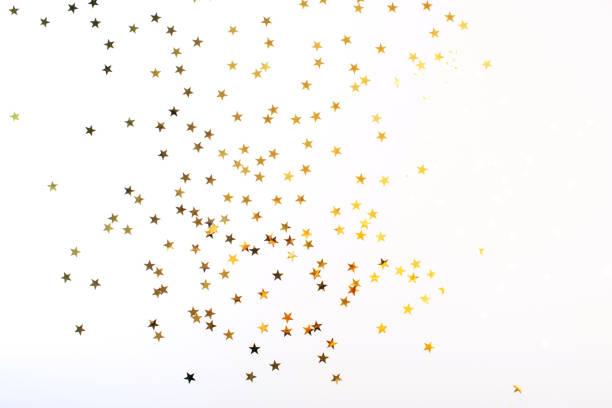 estrelas douradas no fundo branco - estrelinha - fotografias e filmes do acervo