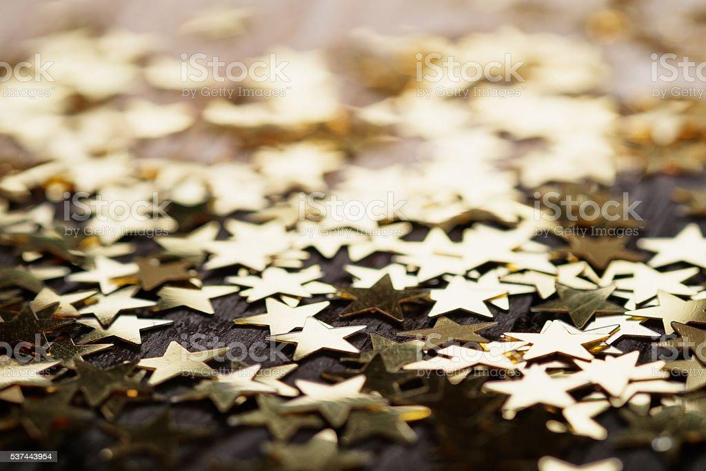Golden stars on wood stock photo