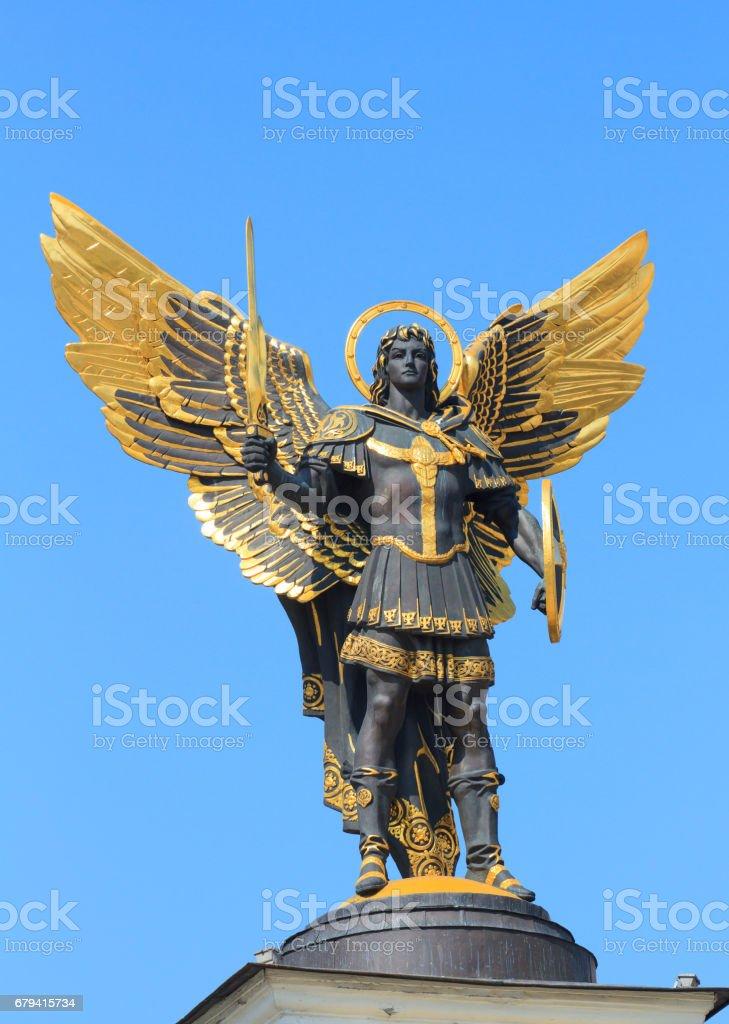 Golden statue in Kiev stock photo