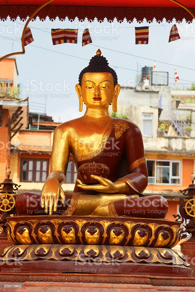 Golden statue of a meditating Buddha stock photo