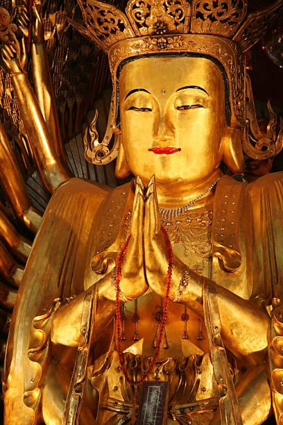 Golden statue of Buddha stock photo