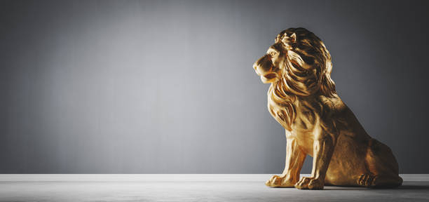 Golden statue of lion, a sculpture. Concept of a strength, power stock photo