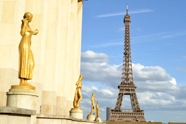 Golden statues at the Trocadero terrace in Paris, the Eiffel Tower in the background. stock photo