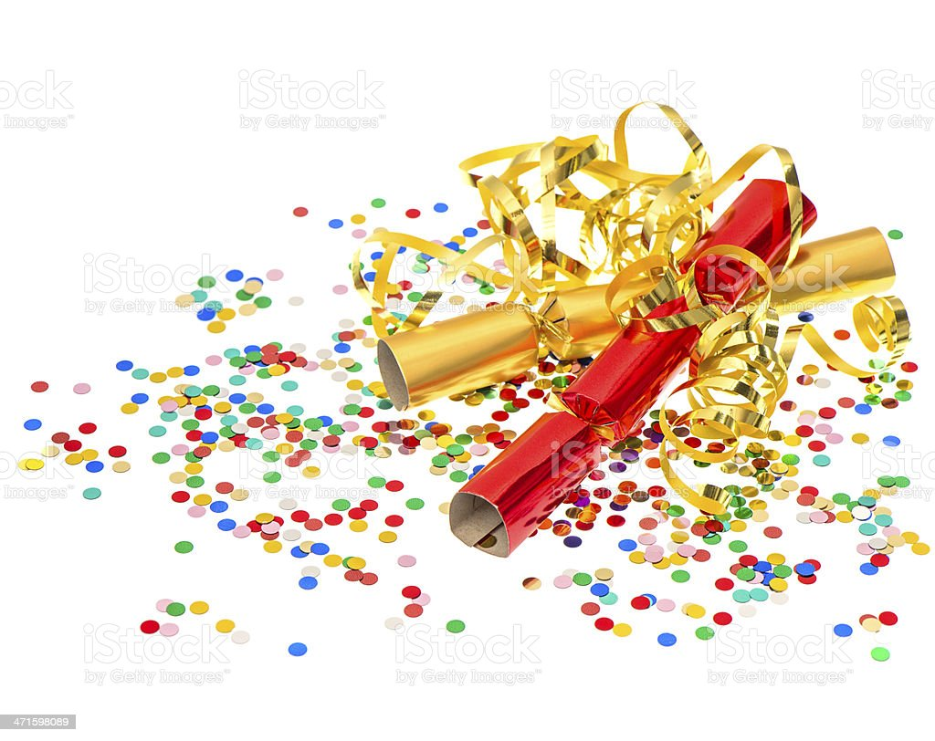 golden streamer, party cracker and confetti over white background royalty-free stock photo