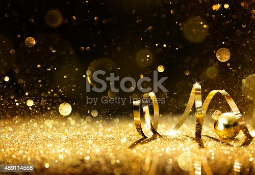 istock Golden streamers with sparkling glitter 489114558