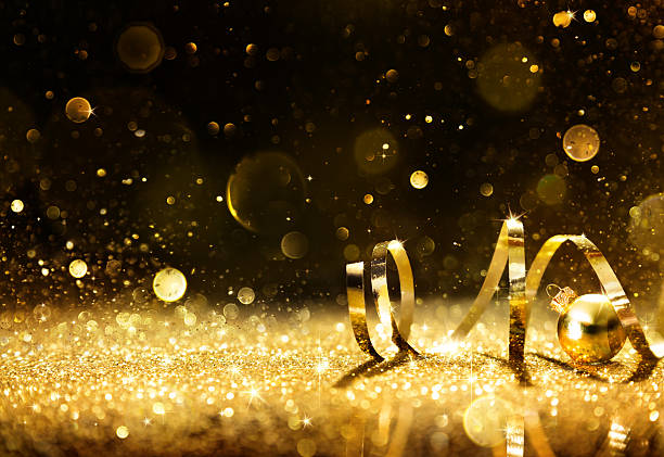 golden streamers with sparkling glitter - anniversary stock photos and pictures