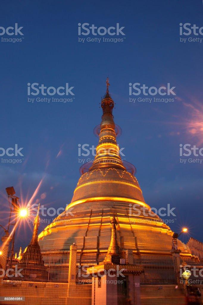 Golden stupa at twilight at Botataung Pagoda, Buddha's First Sacred Hair Relic Pagoda, Yangon (Rangoon), Myanmar, (Burma). stock photo