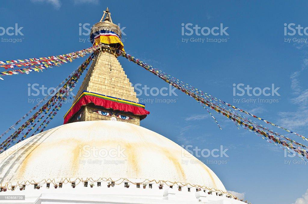 Golden stupa shrine colorful buddhist prayer flags Bodnath Kathmandu Nepal stock photo