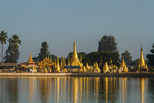golden stupas on pone taloke lake - pone stock photos and pictures