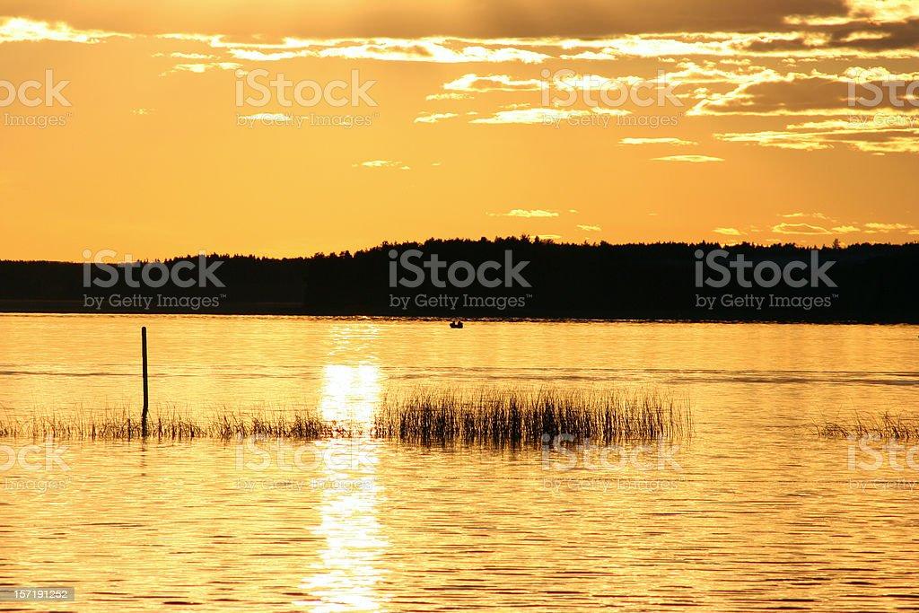 golden sun over Finnish lake royalty-free stock photo