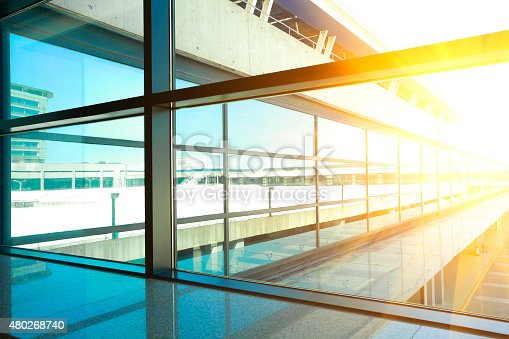 golden sunlight of modern blue glass windows of office building
