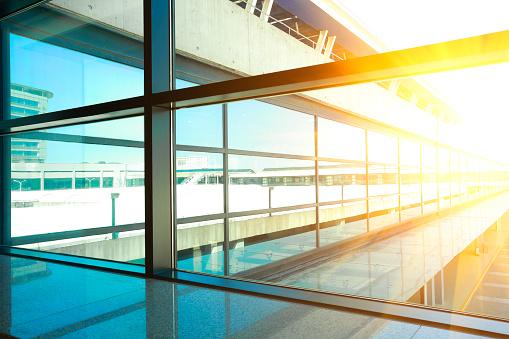 golden sunlight of modern blue glass windows of office building