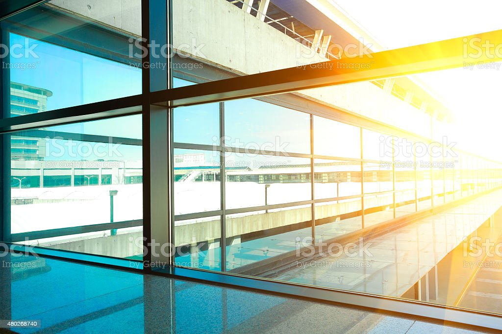 golden sunlight blue of glass windows in modern office building stock photo