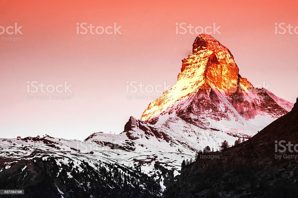 Golden sunlight shine on Matterhorn in early morning stock photo