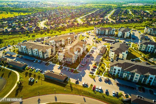istock Golden Sunrise over Apartments and Suburbs in Austin Texas aerial drone view 1149166848