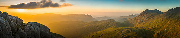 golden sunrise over mountain peaks panorama langdale pikes lake district - cumbria stock photos and pictures