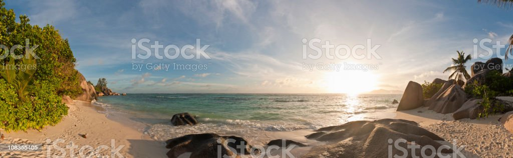 Golden sunset idyllic desert island beach palm trees surf panorama royalty-free stock photo