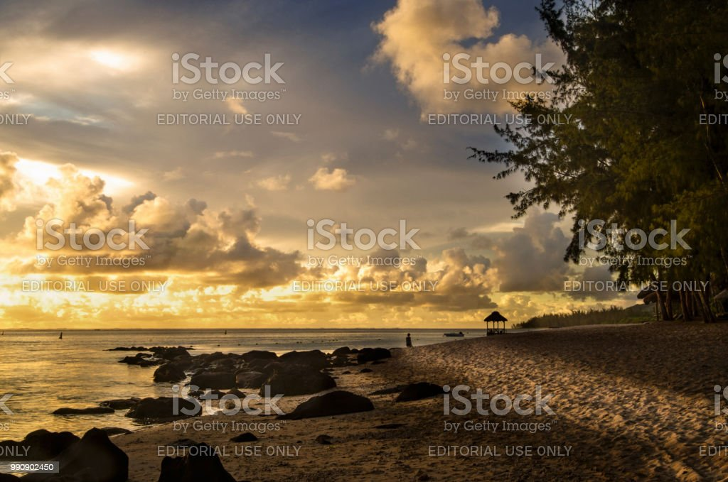A golden sunset in Bel Ombre,Mauritus stock photo