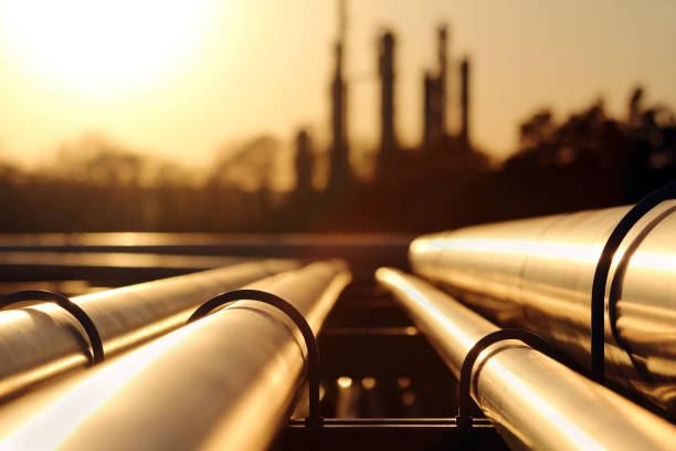 golden sunset in crude oil refinery with pipeline system stock photo