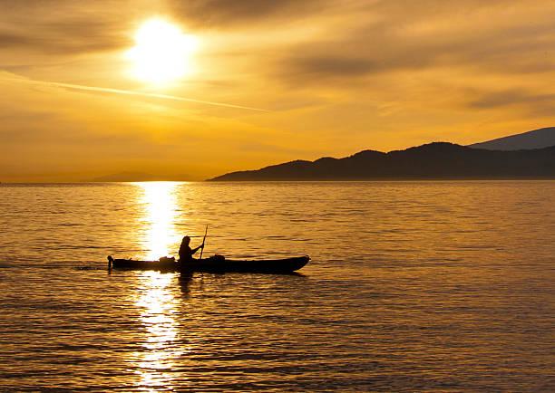 Golden Sunset Kayak Silhouette stock photo
