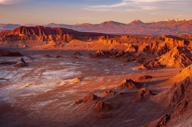 Golden sunset light casting strong shadow on the eerie moonscape at the Moon Valley, Atacama desert, Chile. stock photo