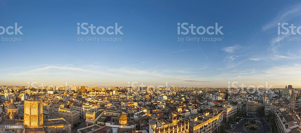 Golden sunset light on city rooftop panorama Valencia Spain stock photo