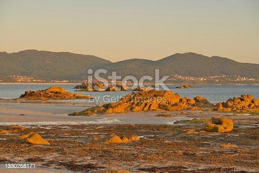 istock Golden sunset on the beach of caldebarcos, costa da morte, Galicia. 1330258171