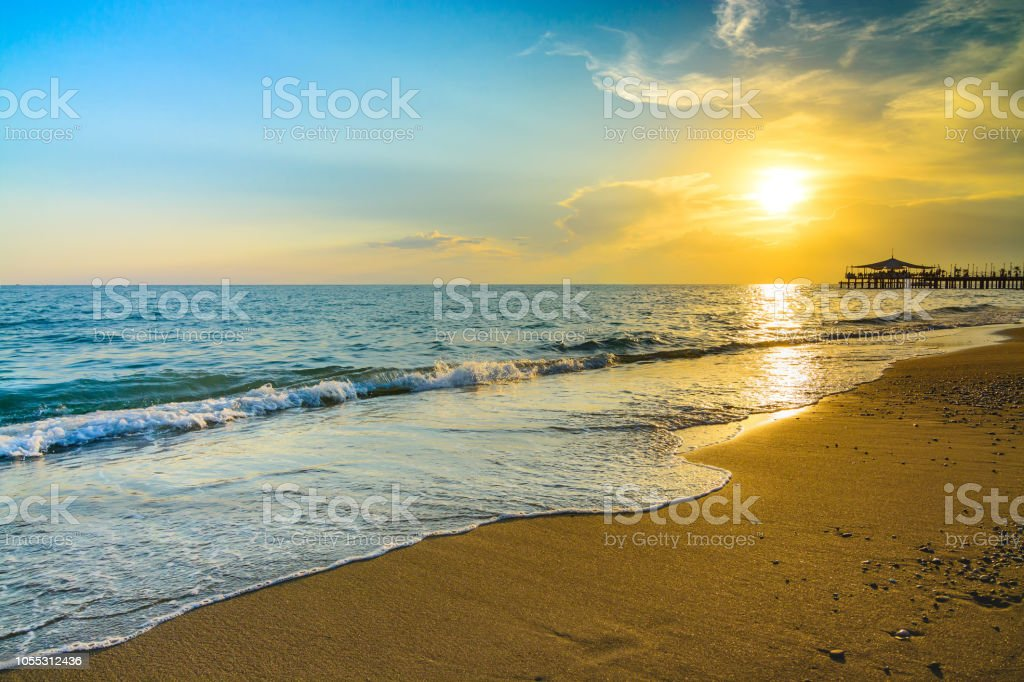 Golden Sunset on the beach stock photo